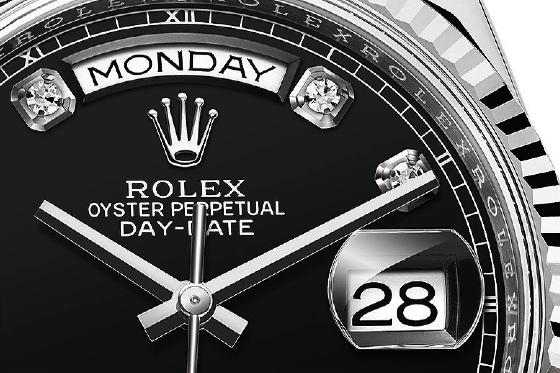 Wochentags- und Datumsfenster bei der Rolex Day-Date.